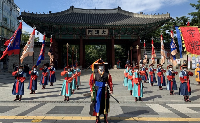 This photo, provided by the Seoul city government on Oct. 20, 2020, shows a ceremony for the changing of royal gatekeepers at Deoksu Palace in Seoul.