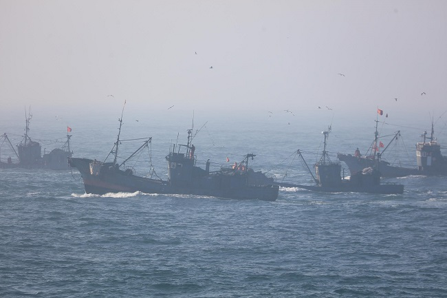 This undated photo provided by the Korea Coast Guard shows Chinese fishing boats illegally operating in South Korean waters in the Yellow Sea.