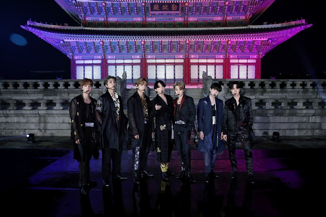 """This photo, provided by Big Hit Entertainment on Sept. 29, 2020, shows K-pop group BTS posing for a photo in front of Geunjeongjeon Hall of Gyeongbok Palace in Seoul, South Korea, where the band filmed a performance for the """"BTS Week"""" special on NBC's """"The Tonight Show Starring Jimmy Fallon"""" in the United States."""