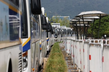 'Wall of Buses' Stirs Up Debate over How Far Police Can Go to Stop Rallies amid Pandemic