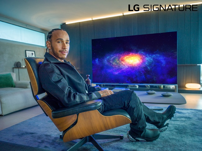 This photo provided by LG Electronics Inc. on Oct. 15, 2020, shows Formula One driver Lewis Hamilton with LG Signature products.