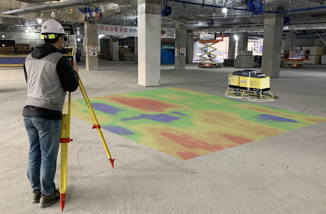 This photo, provided by Hyundai Engineering Co. on Nov. 11, 2020, shows an artificial intelligence-based plastering robot capable of leveling concrete-poured floors with its four blades.