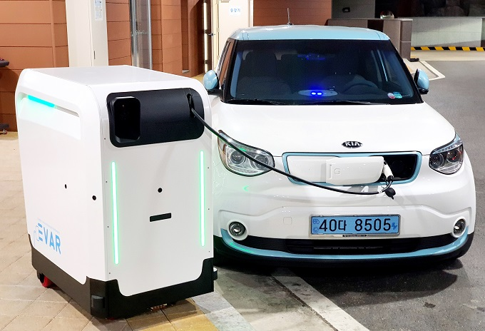 An electric car is being charged at a mobile station on the southern resort island of Jeju on July 29, 2020, in this photo provided by the Ministry of SMEs and Startups.