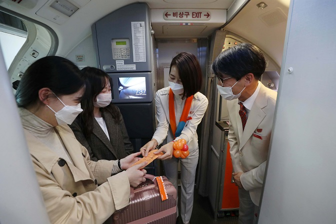 This photo, provided by the Incheon International Airport press pool, shows flight crew checking boarding passes on a Jeju Air flight to nowhere on Oct. 23, 2020.