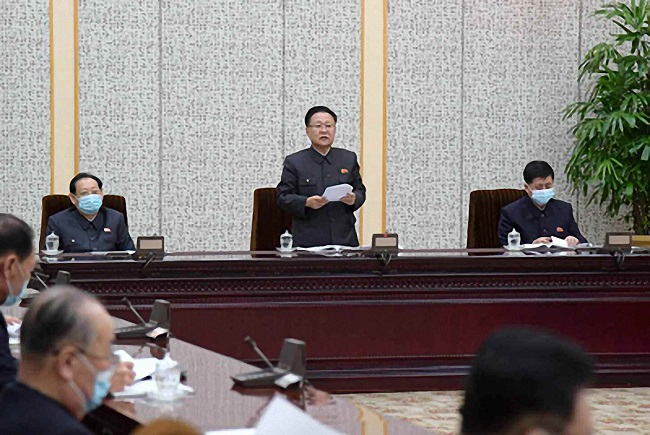 This photo, captured from the website of North Korea's Rodong Sinmun on Nov. 5, 2020, shows the North holding a plenary meeting of the 14th Presidium of the Supreme People's Assembly to discuss the tobacco prohibition law and revision to the enterprise law.