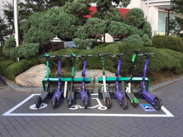 Electric scooters are parked at a designated zone for personal mobility devices in front of Jamsil Station in southern Seoul, in this photo provided by the Songpa District Ward Office on Oct. 7, 2020.