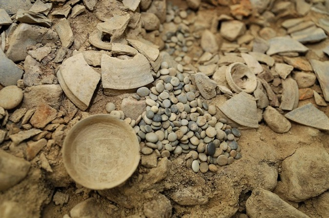 This photo, provided by the Gyeongju National Research Institute of Cultural Heritage on Dec. 7, 2020, shows natural Go stones excavated from an ancient tomb in Gyeongju, South Korea.