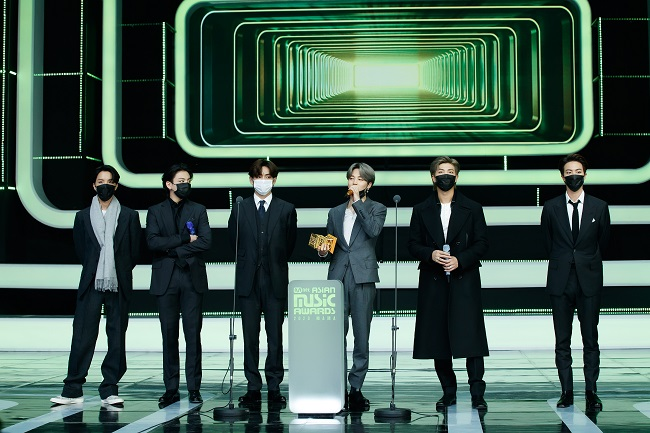 This photo, provided by Mnet, shows BTS taking the stage to accept an award at the Mnet Asian Music Awards (MAMA) held on Dec. 6, 2020.
