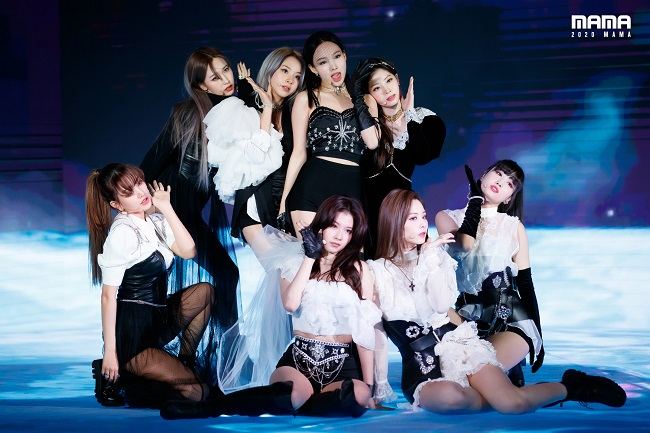 In this photo, provided by CJ ENM, K-pop girl group TWICE performs at the Mnet Asian Music Awards (MAMA) in Seoul on Dec. 6, 2020.