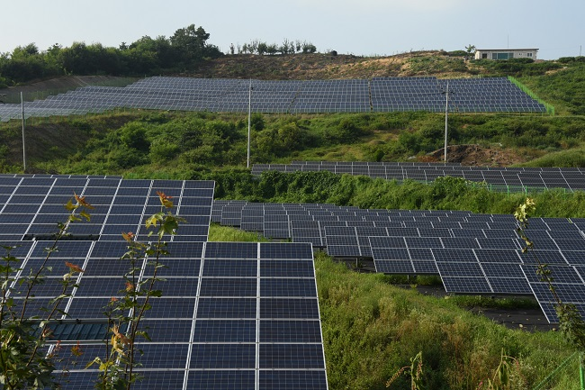This photo, provided by Korea Forest Service on Aug. 7, 2020, shows solar panel facilities set up at a mountain.