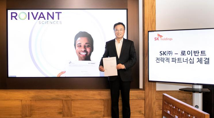 This photo provided by SK Holdings Co. on Dec. 7, 2020, shows the company's CEO Jang Dong-hyun posing for a photo after signing a strategic partnership with U.S. biopharmaceutical firm Roivant Sciences Ltd. on a targeted protein degradation platform.