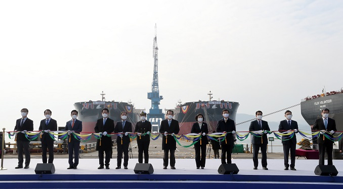 A tape-cutting ceremony is held for the launch of the country's first liquefied natural gas-powered oceangoing ore carriers HL Eco and HL Green at the shipyard of Hyundai Samho Heavy Industries in the port city of Yeongam on South Korea's southwestern coast on Dec. 11, 2020. (Yonhap)