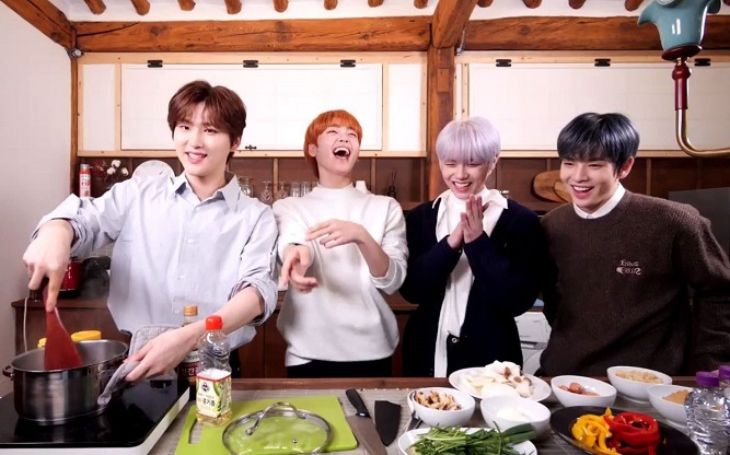 This photo, provided by Airbnb, shows K-pop boy band Cravity cooking a Korean dish during an online session hosted by the American accommodation rental company.