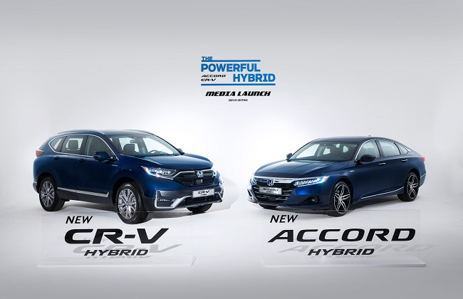 This file photo provided by Honda Korea shows the new CR-V hybrid and the upgraded Accord hybrid models.