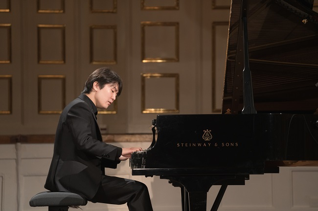 In this photo provided by Universal Music, South Korean pianist Cho Seong-jin plays Mozart's previously unheard piece at an online recital during the digital Mozart Week 2021 in Salzburg, Austria, on Jan. 27, 2021.