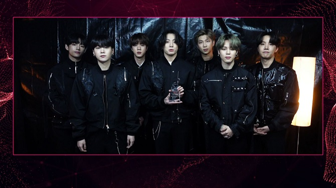 This photo, provided by Gaon Chart, shows BTS holding a trophy for the 2021 Gaon Chart Music Awards held on Jan. 13, 2021.