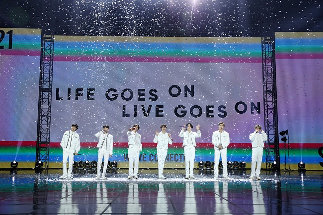 """This photo, provided by Big Hit Entertainment, shows BTS performing """"Life Goes On"""" during an year-end concert hosted by their agency-label on Dec. 31, 2020."""