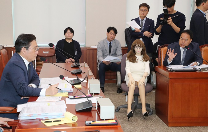 This file photo, taken Oct. 18, 2019, shows South Korean legislators debating over the import of lifesize sex dolls during an annual parliamentary audit on the Ministry of Trade, Industry and Energy in the National Assembly Complex in southern Seoul. (Yonhap)