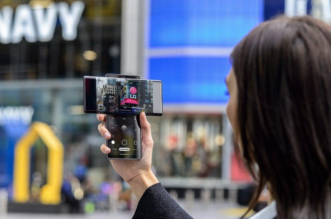 This file photo, provided by LG Electronics Inc. on Oct. 16, 2020, shows a model holding the company's dual-screen smartphone, the Wing.