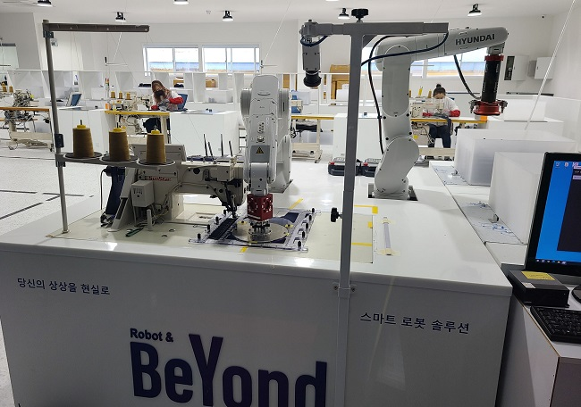 A smart sewing factory based on 5G network and ICT solutions in Iksan, 220 kilometers south of Seoul, is shown in this photo provided by North Jeolla Province on Dec. 22, 2020.