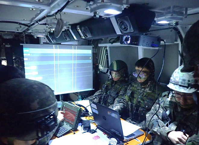 In this undated photo, provided by the arms procurement agency on Jan. 25, 2021, troops are seen inside a command post vehicle. The agency said the vehicle's development, which began in 2017, was completed earlier in the month.