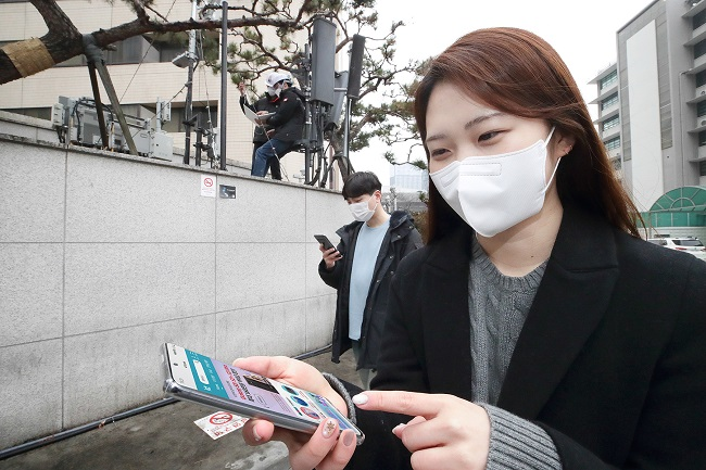 This photo, provided by KT Corp. on Jan. 27, 2021, shows the company's workers testing standalone 5G near its offices in central Seoul.
