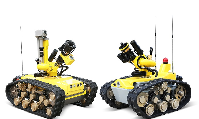 This photo, provided by Doosan Corp. on Feb. 8, 2021, shows two firefighting robots produced by Chinese robot maker CITIC HIC Kaicheng Intelligence Equipment Co.