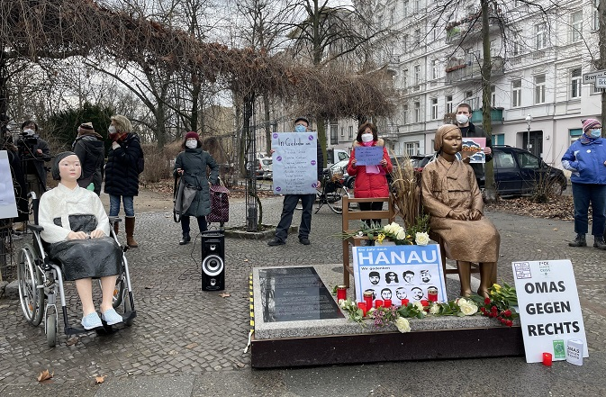 Activists and citizens hold a rally in front of the Statue of Peace in Berlin on Feb. 19, 2021. (Yonhap)