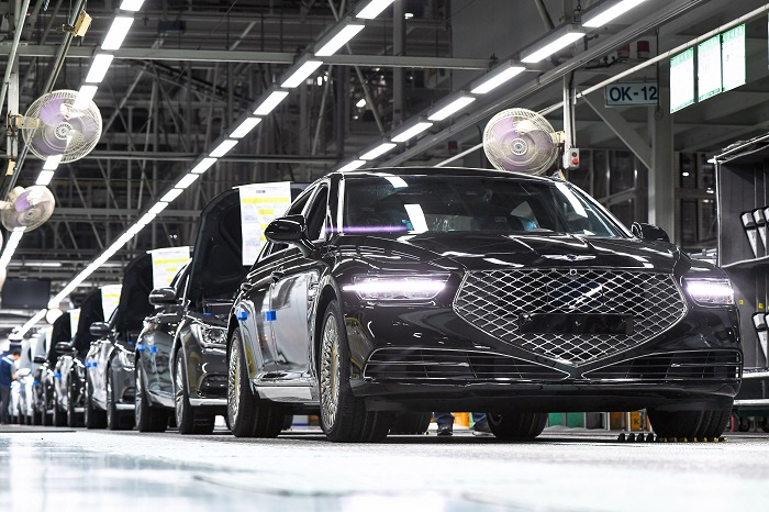 This undated photo provided by Hyundai Motor Co. shows a production line of Genesis sedans.