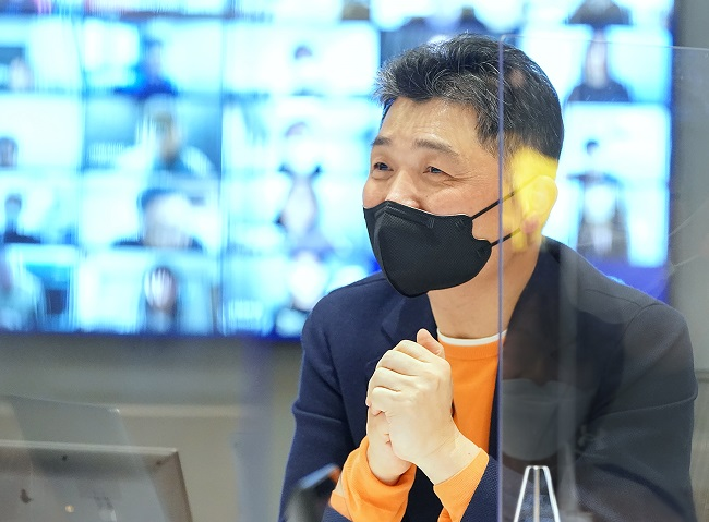 This photo provided by Kakao Corp. on Feb. 25, 2021, shows Kakao founder Kim Beom-su speaking at an online conference with his employees.