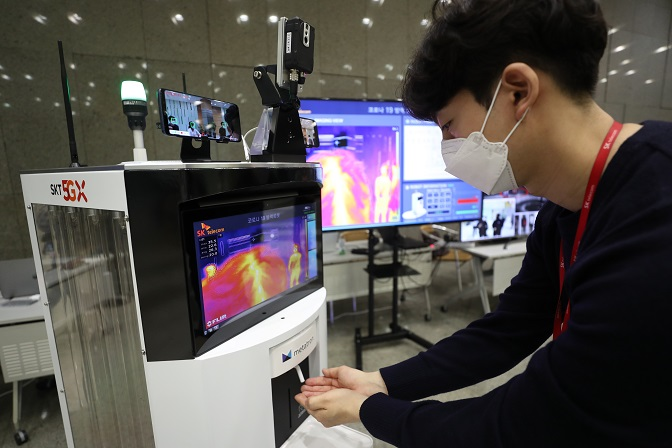 This file photo, taken May 26, 2020, at SK Telecom Co.'s office in central Seoul, shows the company's robot equipped with IoT sensors to prevent the spread of the novel coronavirus.