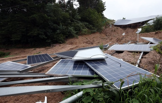 A solar facility set on a mountain slope collapsed in Jaecheon, North Gyeongsang Province on Aug. 8, 2020. (Yonhap)