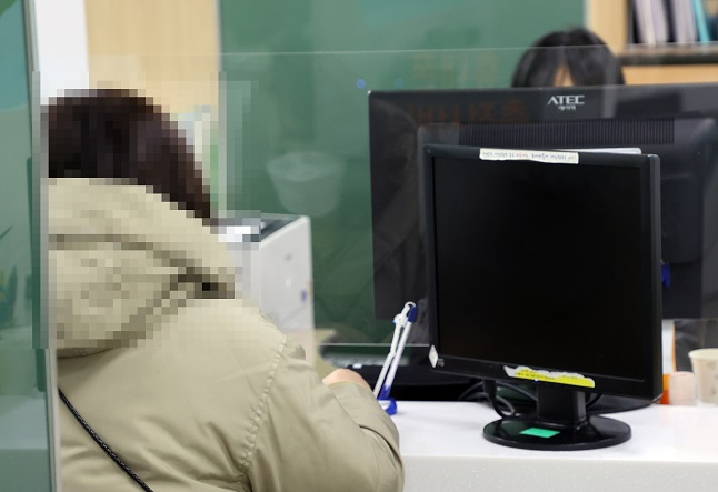 This undated file photo shows a women getting job counseling at an employment and welfare center in Seoul. (Yonhap)