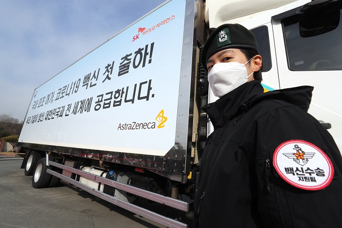 A military official stands next to a truck carrying AstraZeneca's COVID-19 vaccines in Andong, 268 kilometers south of Seoul, on Feb. 24, 2021. (Yonhap)
