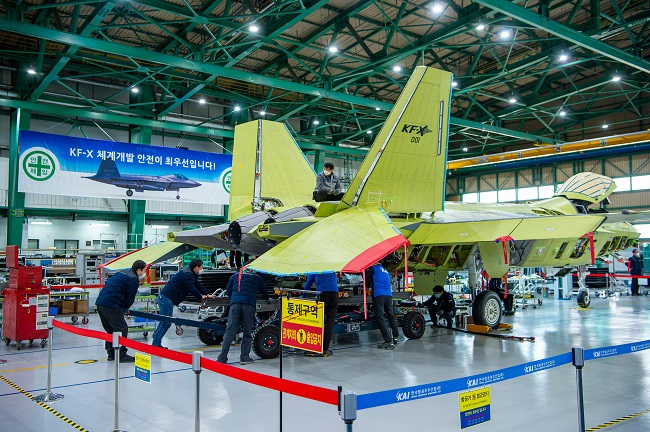 Workers of the Korea Aerospace Industries (KAI) assemble a prototype of South Korea's first indigenous fighter jet KF-X at its plant in the southeastern city of Sacheon on Feb. 24, 2021, in this photo provided by the arms procurement agency.
