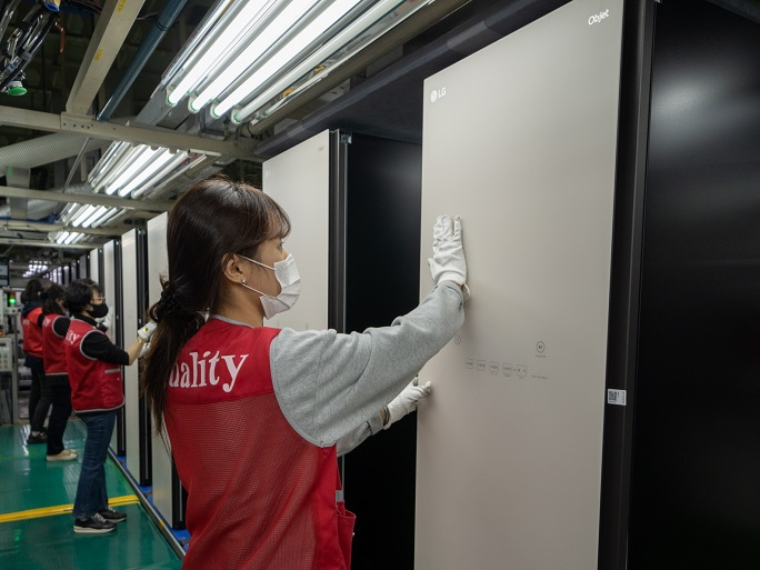 This photo provided by LG Electronics Inc. on March 2, 2021, shows a worker checking the Styler steam clothing care appliance at the company's plant in Changwon, some 400 kilometers south of Seoul.