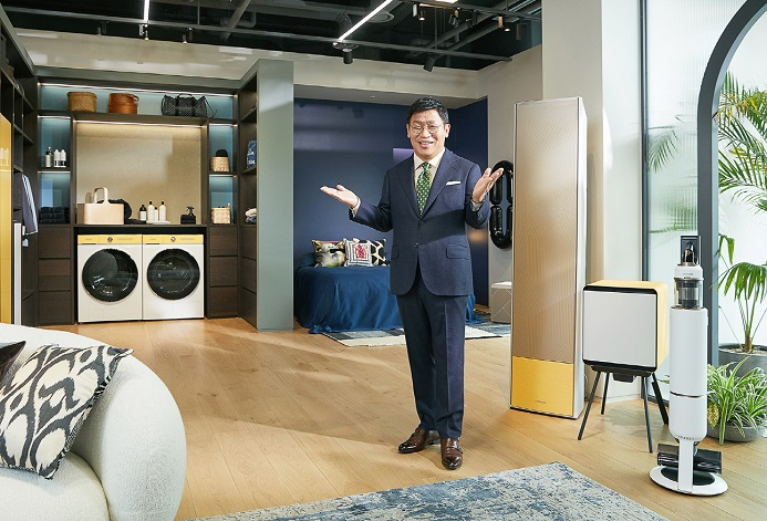 This photo provided by Samsung Electronics Co. on March 9, 2021, shows Lee Jae-seung, who heads Samsung's home appliance business, introducing the company's customizable BESPOKE home appliances.