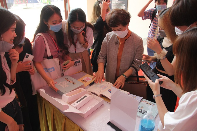 Vietnamese students and faculty at Thang Long University in Hanoi check out Korean language study material provided by global K-pop sensation BTS, on Aug. 27, 2020, in this photo provided by Korean News in Hanoi.