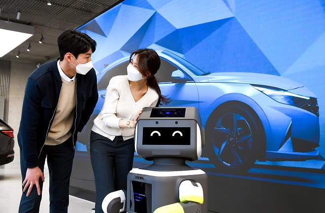 """This photo provided by Hyundai Motor Group shows its """"DAL-e,"""" a highly advanced customer service robot."""