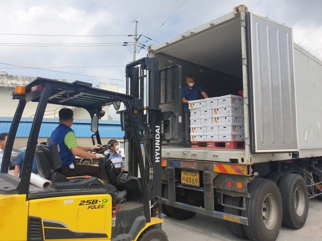 Boxes containing paprika are loaded onto a truck for exports to China, at an agricultural cooperative in Namwon, South Jeolla Province, on Aug. 25, 2020, in this photo provided by the agriculture ministry. The exports are the first of their kind.