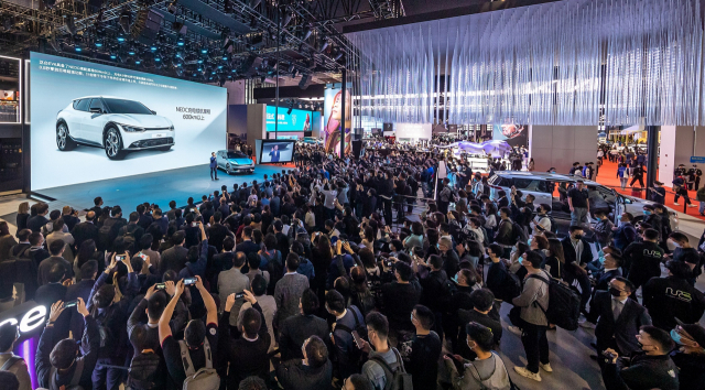 Kia Corp.'s showcase event for the EV6 at the Shanghai International Automobile Industry Exhibition on April 19, 2021, is crowded with reporters and visitors, in this photo provided by Kia.