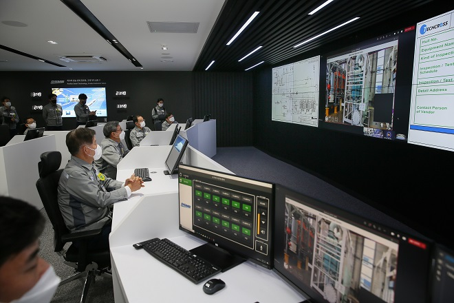 This photo provided by Daewoo Shipbuilding & Marine Engineering Co. on April 8, 2021, shows officials at the shipbuilder looking at screens at its Digital Production Center located at its Okpo shipyard on Geoje Island, 398 kilometers south of Seoul.