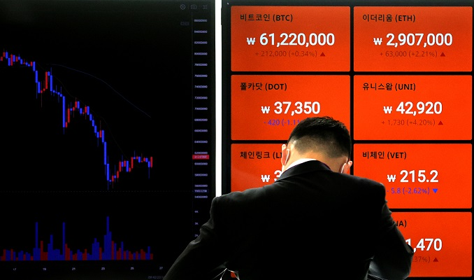 The photo, taken April 26, 2021, shows signboards tracking price movements of Bitcoin and other virtual currencies on the local exchange Bithumb in Seoul. (Yonhap)