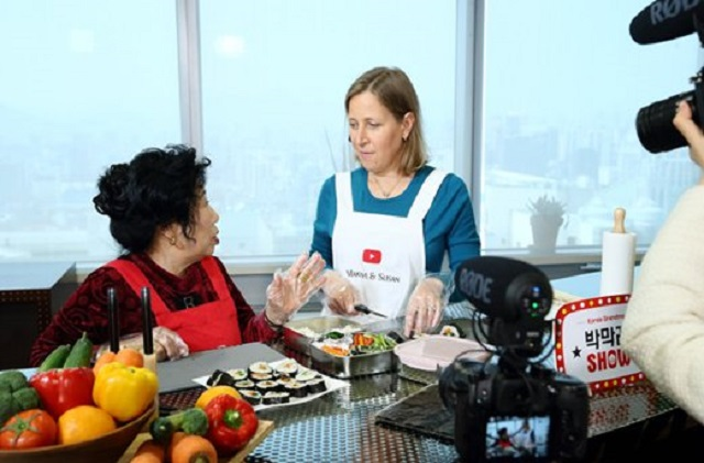 This file photo, provided by YouTube, shows South Korean YouTuber Park Mak-rye teaching cooking to YouTube CEO Susan Wojcicki.