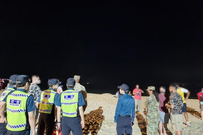 USFK Members who Hold No-mask Parties on Haeundae Beach During Independence Day to be Fined