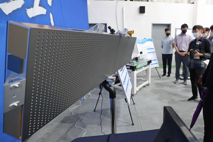 This file photo, taken Aug. 5, 2020, shows a mini satellite on display at the Agency for Defense Development's testing center in Taean, 150 kilometers southwest of Seoul. (Yonhap)