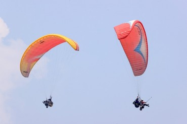 Disabled Persons with Spinal Cord Injuries Participate in Paragliding Event
