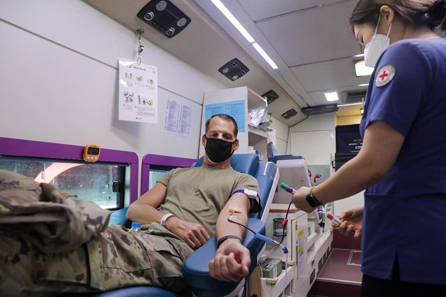 This photo provided by the U.S. Forces Korea (USFK) shows an American service member donating blood during at Camp Humphreys in Pyeongtaek, Gyeonggi Province, on July 21, 2021.