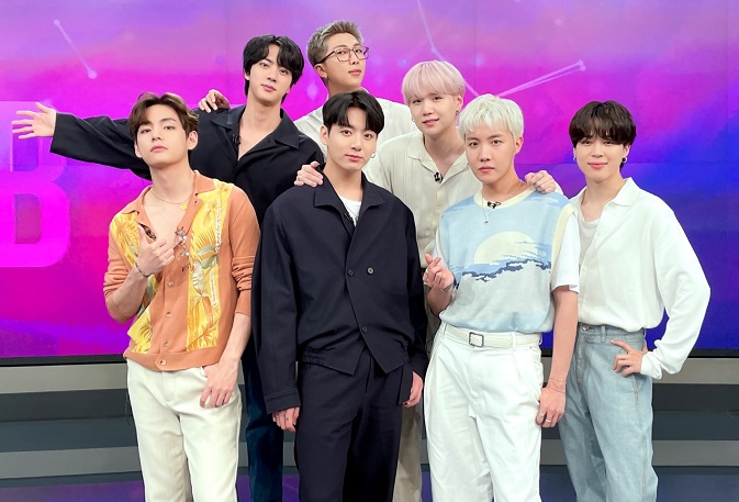 This photo, posted on BTS' official Twitter account, shows the group posing at a studio during its appearance on SBS News on July 24, 2021.
