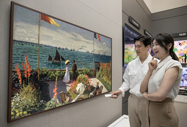 This photo provided by Samsung Electronics Co. on July 25, 2021, shows the company's new 85-inch The Frame TV displayed at a store in Seoul.